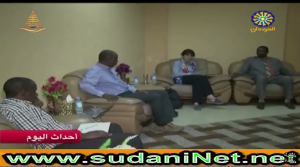 photo of Helen Young, Hussein Sulieman, and Hafiz with the minister in Sudan