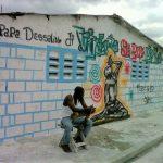 man in front of graffitti Haiti